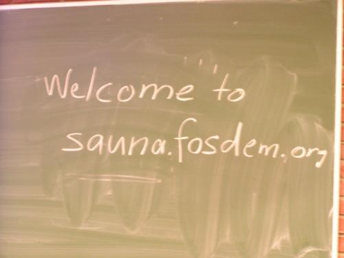 Napis kredą na tablicy: Welcome to fosdem.mozilla.org